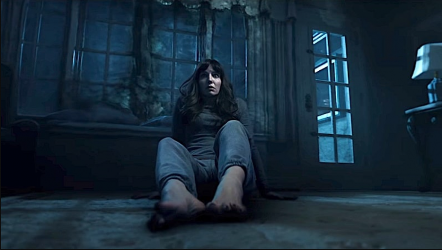 Madison (Annabelle Wallis) is left in utter horror by a vision in Malignant. The film is now in theaters and available to stream on HBO Max.