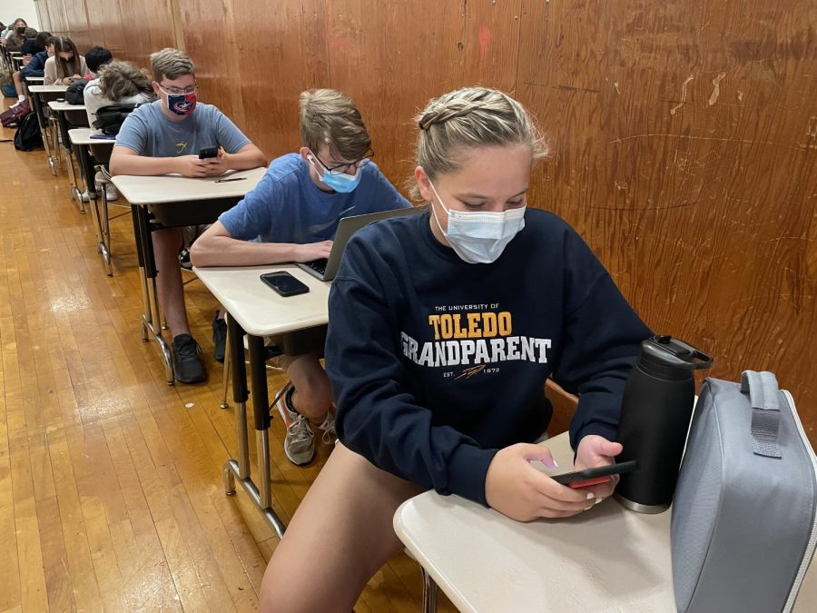 Seniors Chloe Jeffers and Liam Harding wear their masks during study hall.  Masks are now required at all times inside school buildings.