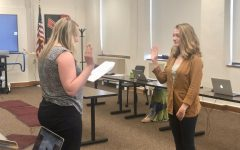 Katie Hejmanowski being sworn in as the new student representative on the board of education.