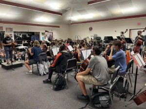 Hayes symphony orchestra practices during the school day. The orchestra and choir are planning a joint trip to NYC this spring.