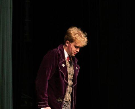 Boy walks onto stage