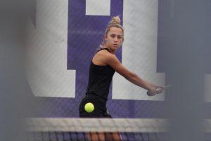 Cassie Klumpp plays tennis.