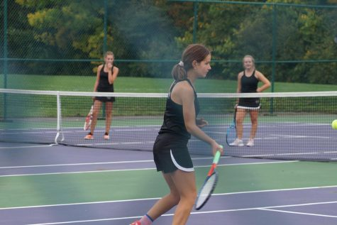 Tea hits ball, Delaney and Autumn watch.